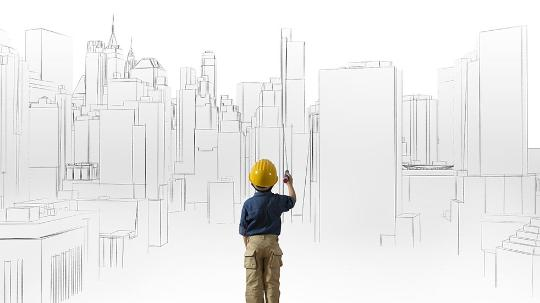 Young boy sketching buildings