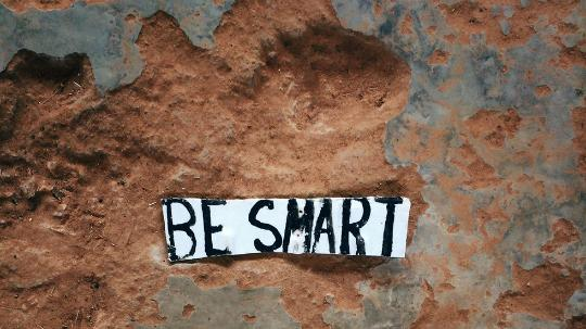 Be smart sign on rocks