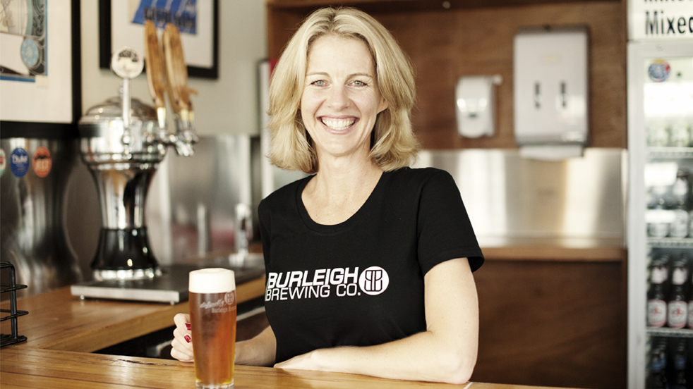 Peta Fielding from Burleigh Brewery sitting down with a beer