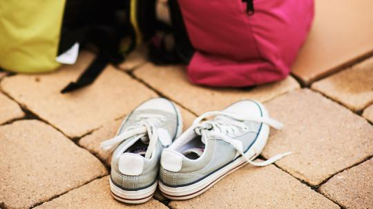 Pair of shoes and school bags.