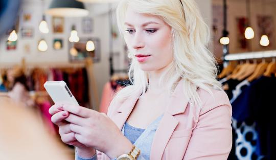 Women in store using smartphone
