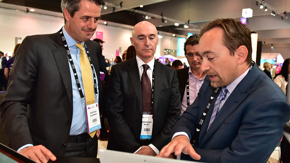 Group of businessmen viewing a connected device
