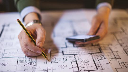 A close up image of an architect drawing on a construction map