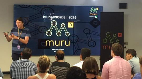 A muru-D mentor speaking in front of new startups