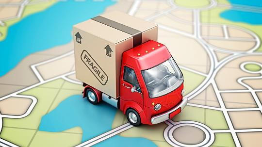A toy truck sitting on a paper map.