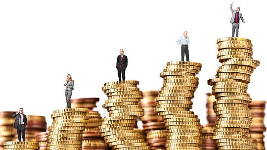 business people standing on coins