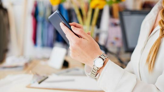 Businesswoman using tablet device in workplace