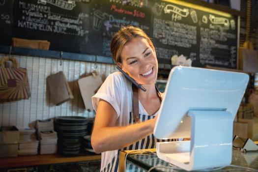 Waitress talking on the phone and placing an order
