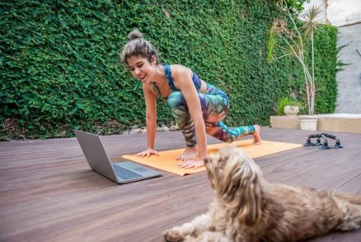 Woman practices yoga at home